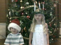 Rylee dressed as St. Lucia and Henry is Santa's Helper