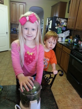 Rylee and Henry making pesto
