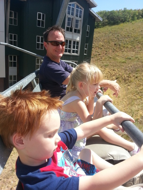 Henri with kids on ski lift