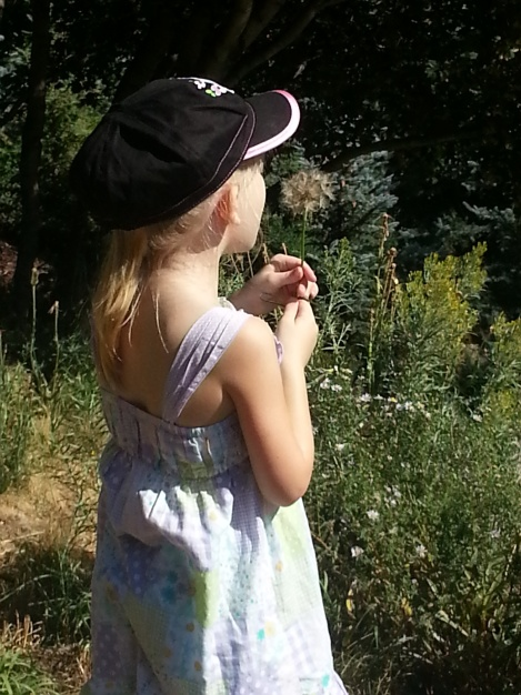 Rylee making a wish while hiking
